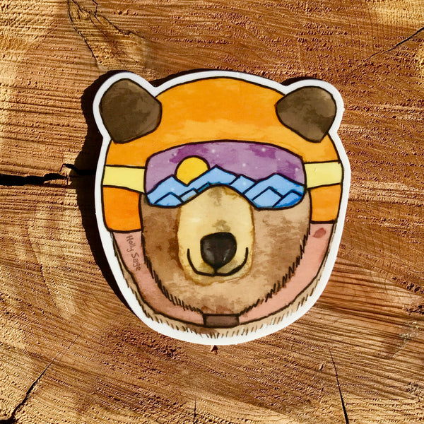 Black bear sticker in ski goggles and helmet