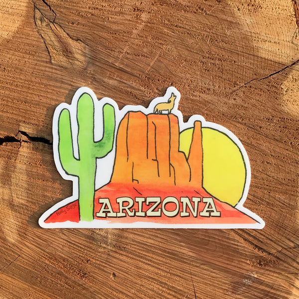 Arizona sticker with sandstone butte, saguaro cactus, sunset, and howling coyote