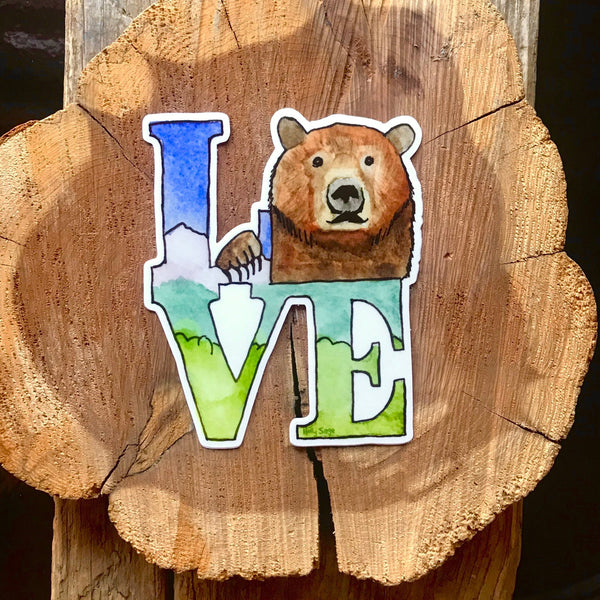 LOVE statue sticker with a grizzly bear in place of the O