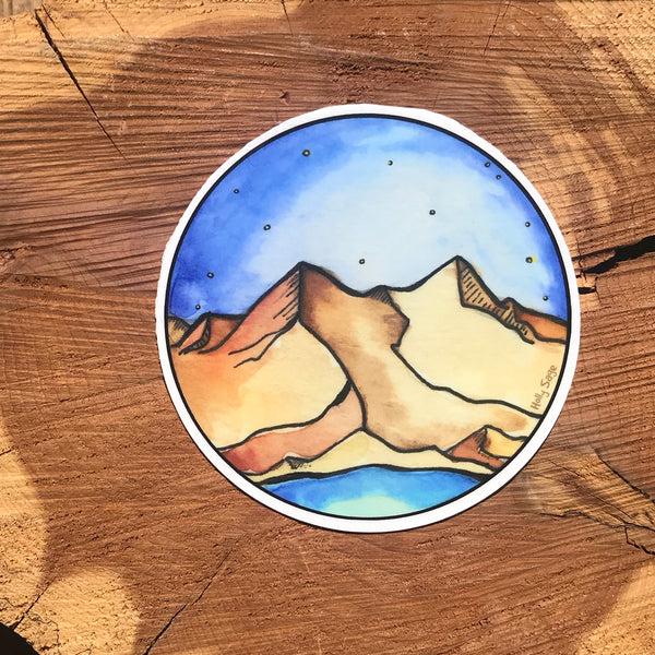 Mountain landscape under a blue sky sticker