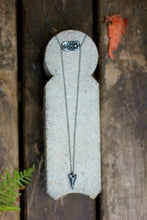 flat lay of gunmetal layering necklace on stone
