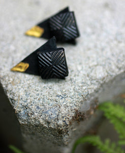 black triangle ear jackets lying on a stone