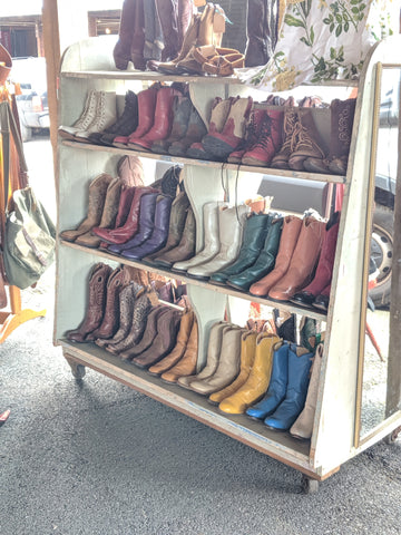 Vintage cowboy boot display, country living fair rhinebeck