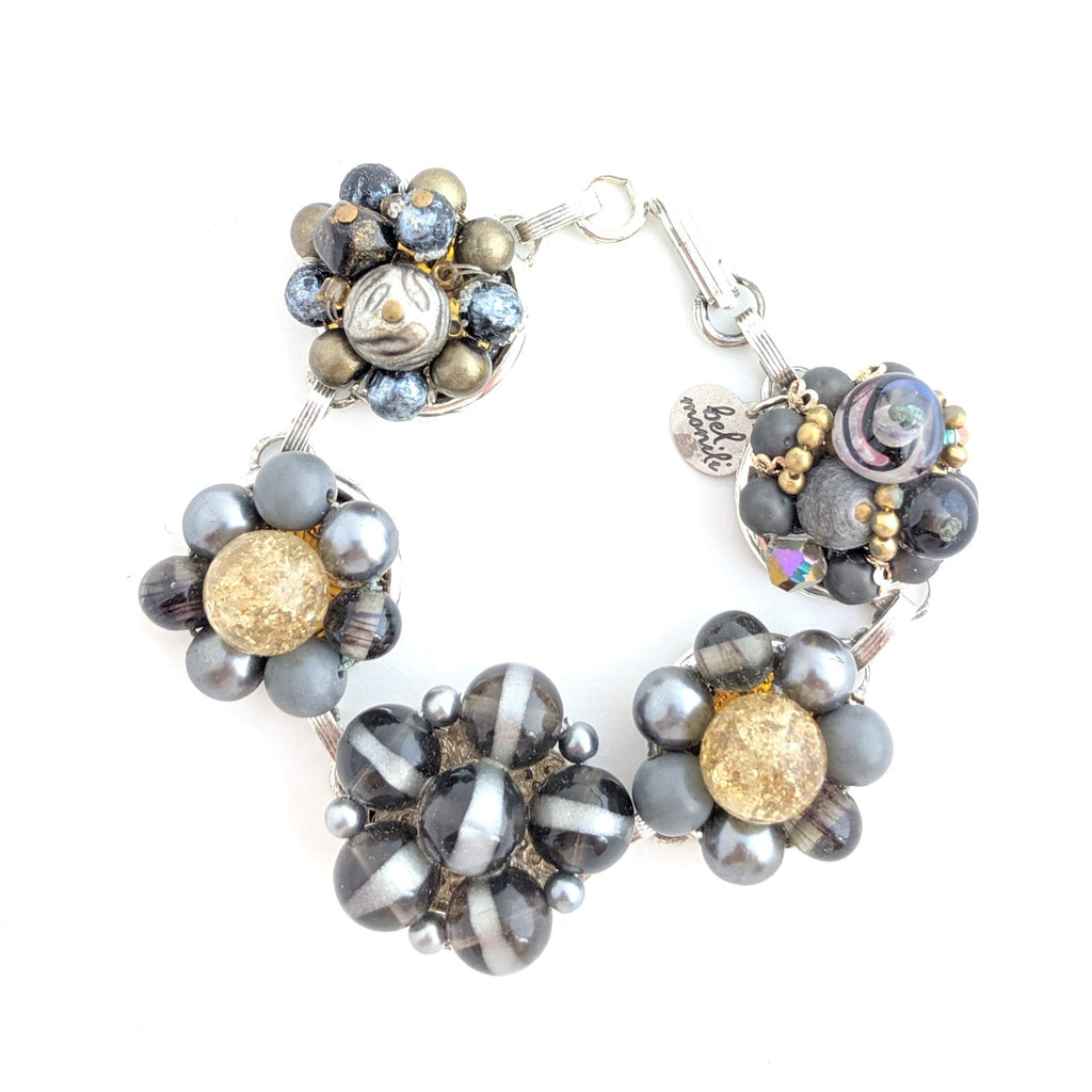 gray and gold statement bracelet