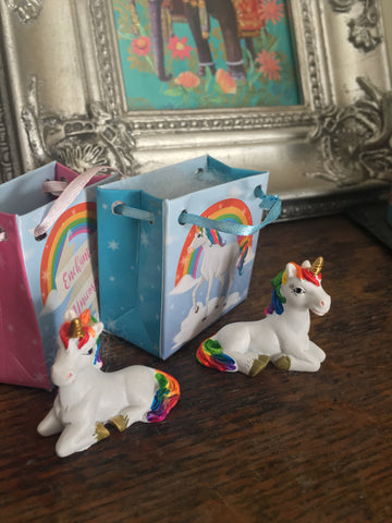 Resin rainbow unicorn gift bag figure. Can be used as a cupcake topper for the cutest final touch to your unicorn party.