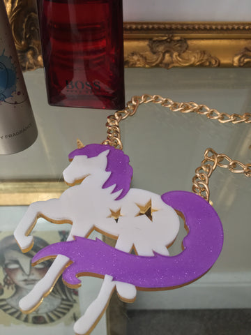 Bold street style laser cut acrylic unicorn fashion necklace on chunky hip hop style gold coloured chain