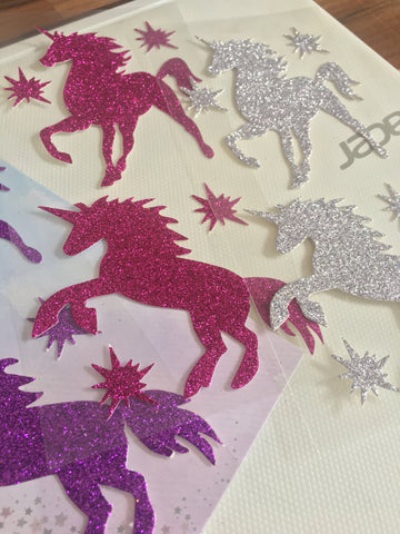 Unicorn and stars silhouette glitter sticker packs in silver, purple or pink. Pack of 2 unicorn stickers.
