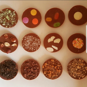 CRUSHED BOURBON MILK CHOCOLATE CIRCLES