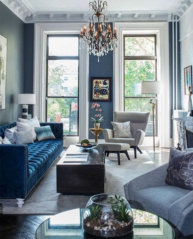 Classic blue living room with chandelier