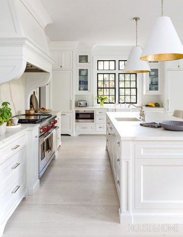 White kitchen with white floors and ceiling