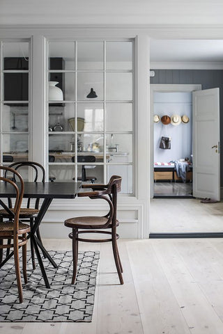 Pale gray kitchen with table and wooden chairs