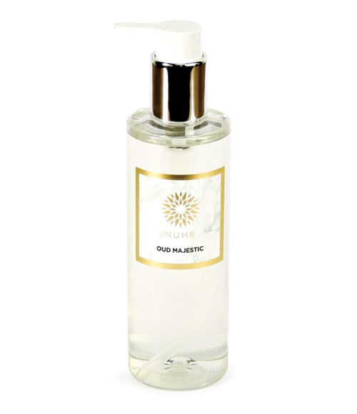 Oud Majestic Body Wash in clear cylindrical bottle with silver collar and white nozzle