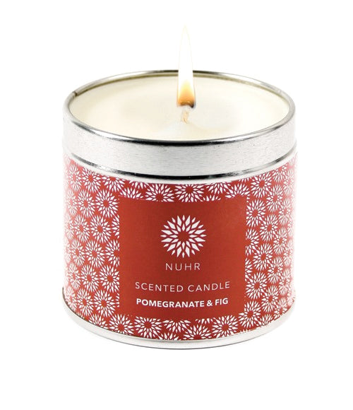 Lit White Pomegranate and fig candle in a silver container and red logo wraparound label