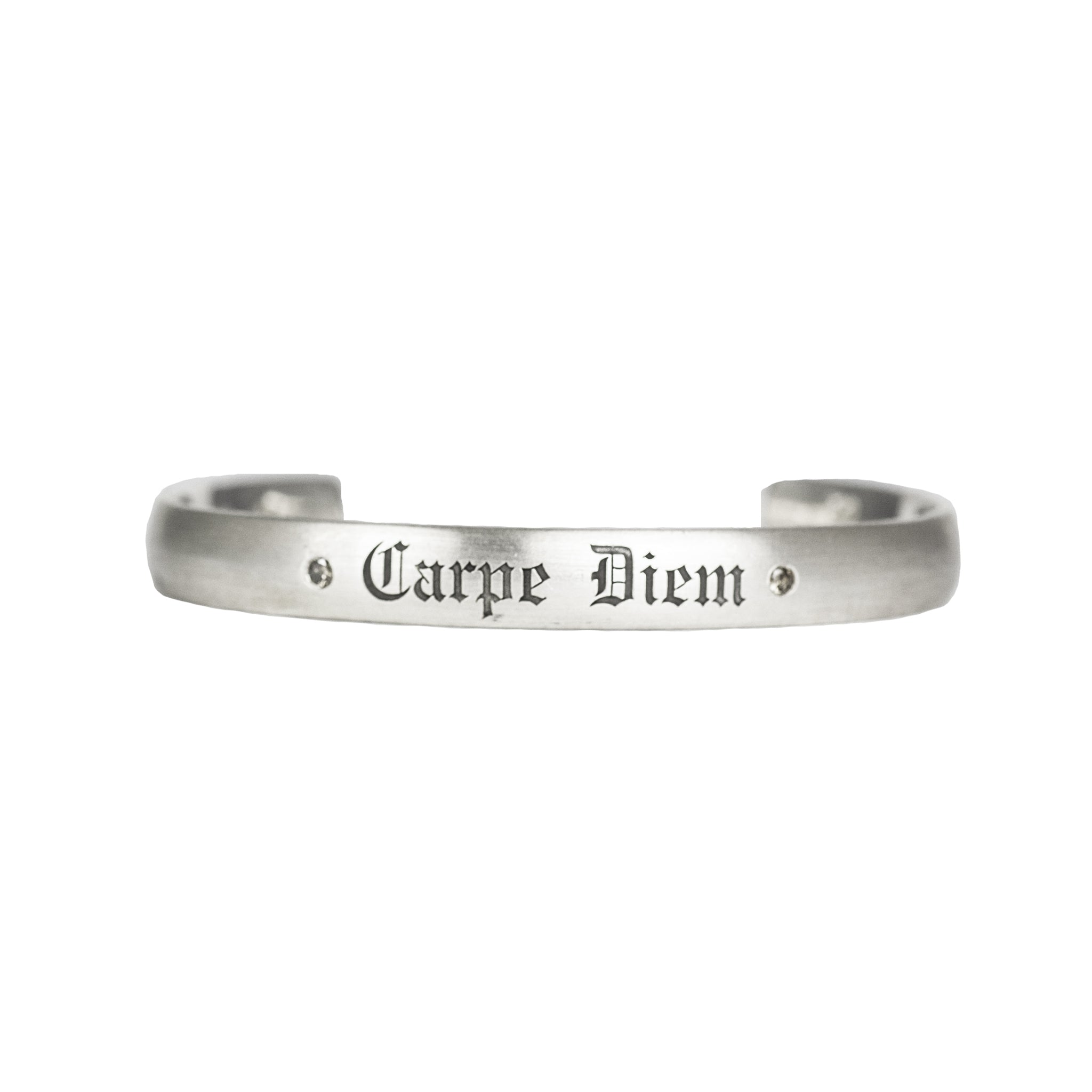 "Satin brushed sterling silver cuff bracelet with champagne diamonds next to custom engraving reading ""Carpe Diem"" in fine Gothic letters"