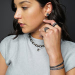Black diamond and champagne diamond sterling silver jewelry styled on a model