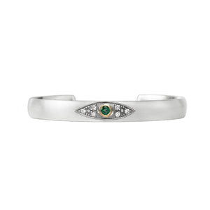 Sterling silver stacking cuff with emerald evil eye in 14K Yellow gold bezel with champagne diamonds