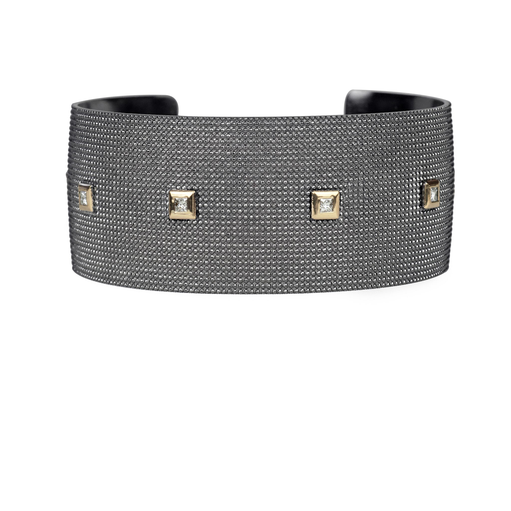 Wide textured sterling silver cuff with 14K gold bezeled white diamonds