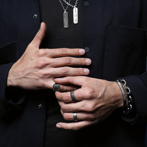 Closeup of menswear jewelry styled
