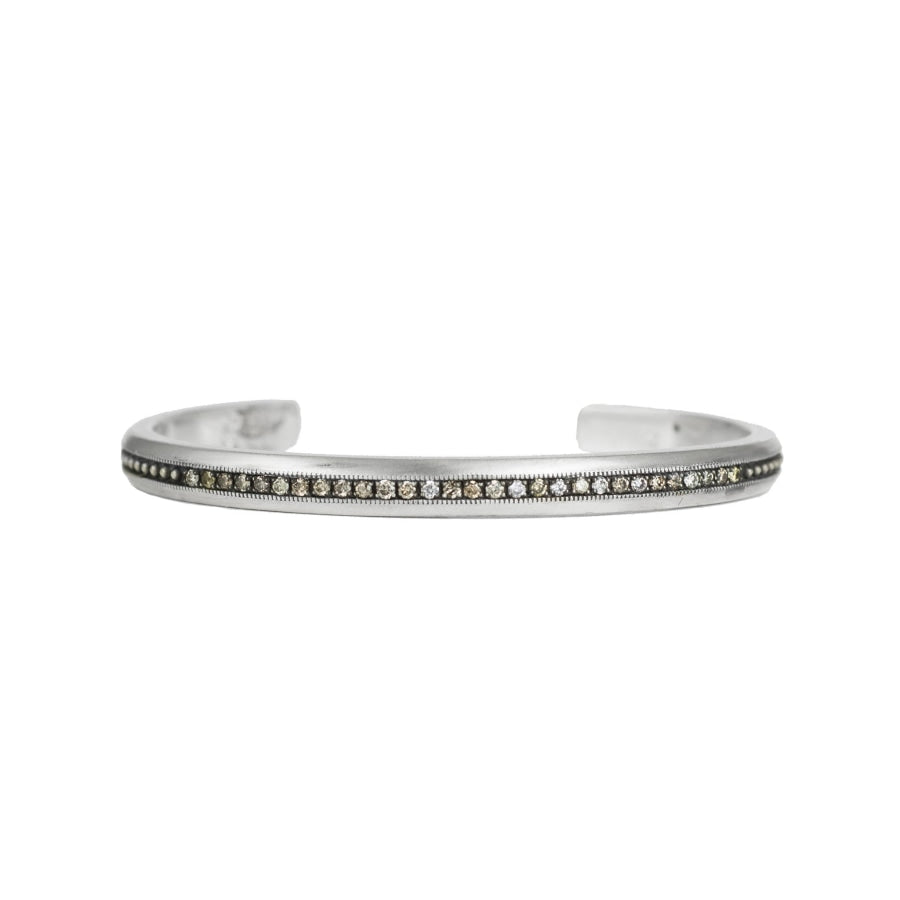 Vintage sterling silver cuff bracelet with center row of champagne diamonds