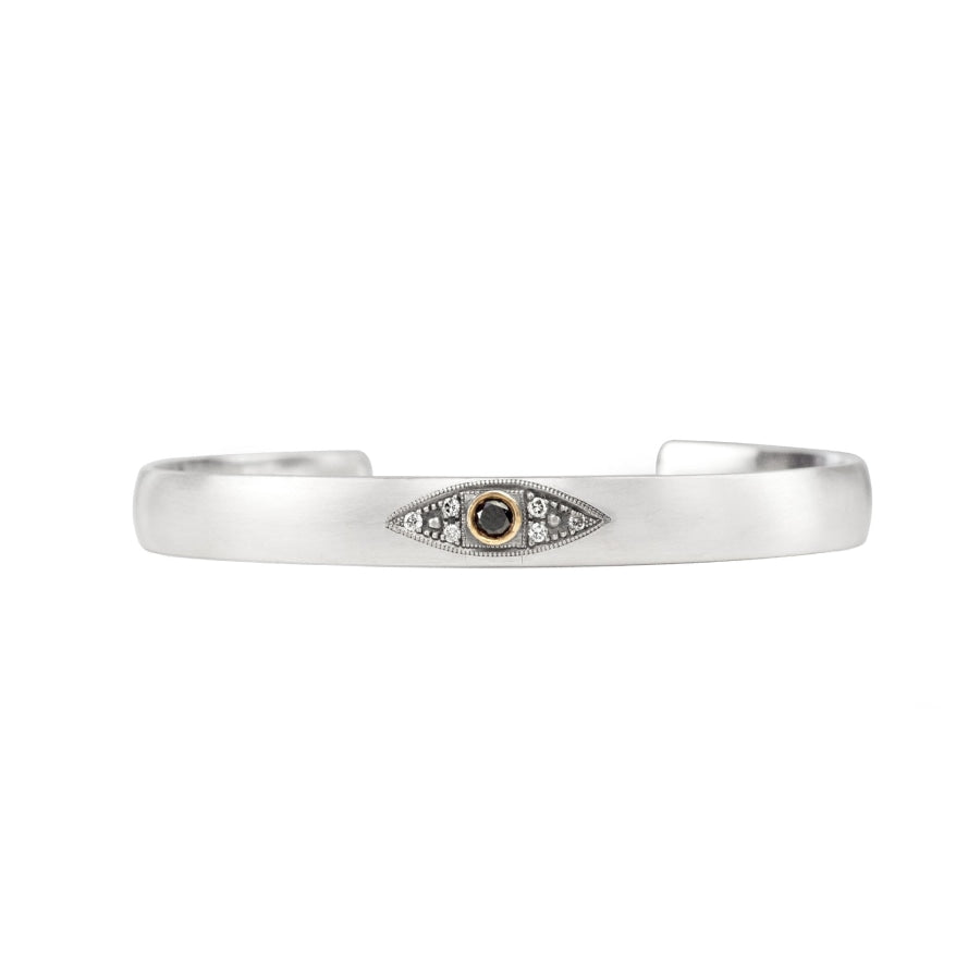 Sterling silver stacking cuff with black diamond evil eye in 14K yellow gold bezel with champagne diamonds