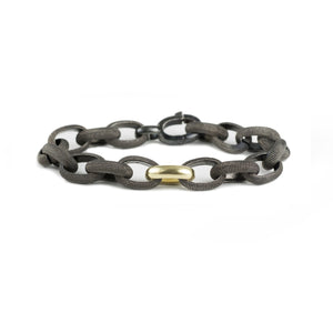 Black rhodium textured silver link bracelet with yellow gold accent link