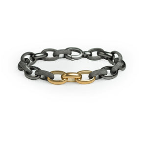 Textured silver link bracelet with three yellow gold accent links