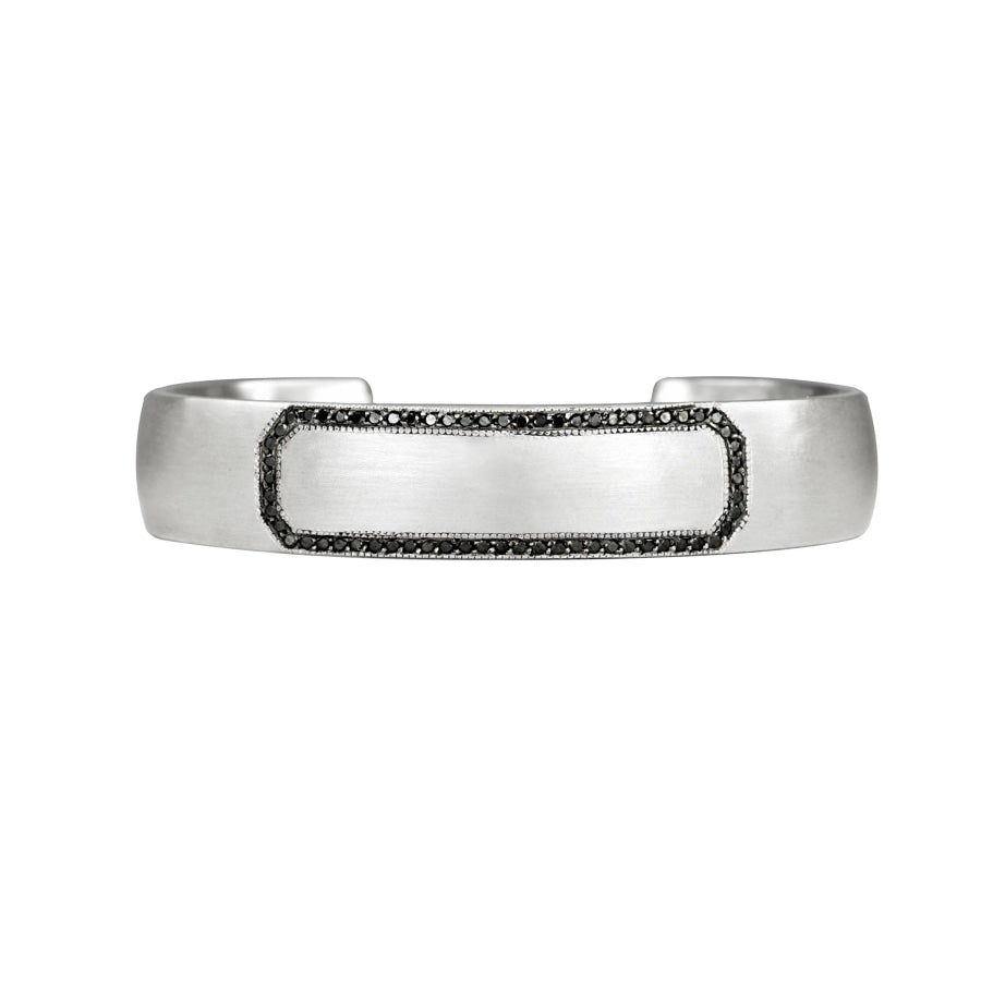 Sterling silver cuff bracelet with black diamond border and blank center space that is engraveable