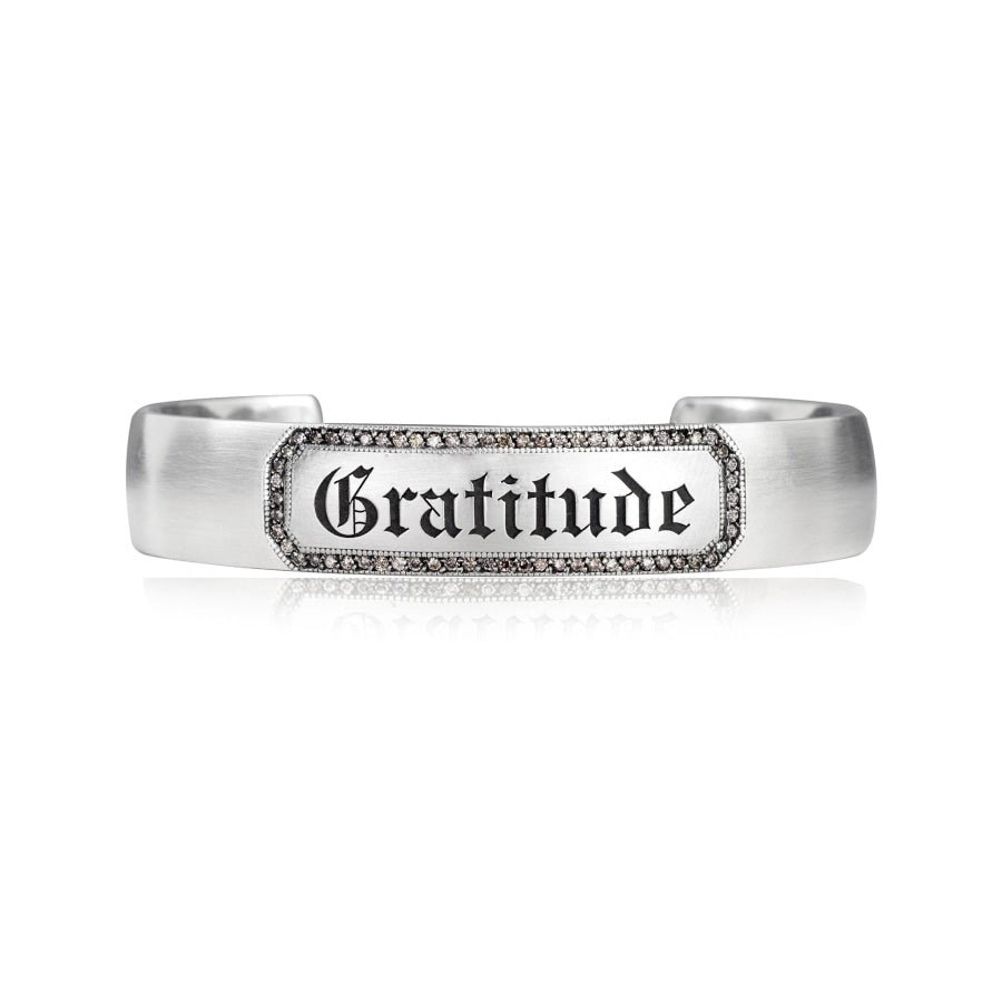 "Engraveable sterling silver cuff bracelet with champagne diamond border around engraved ""Gratitude"" in gothic letters"
