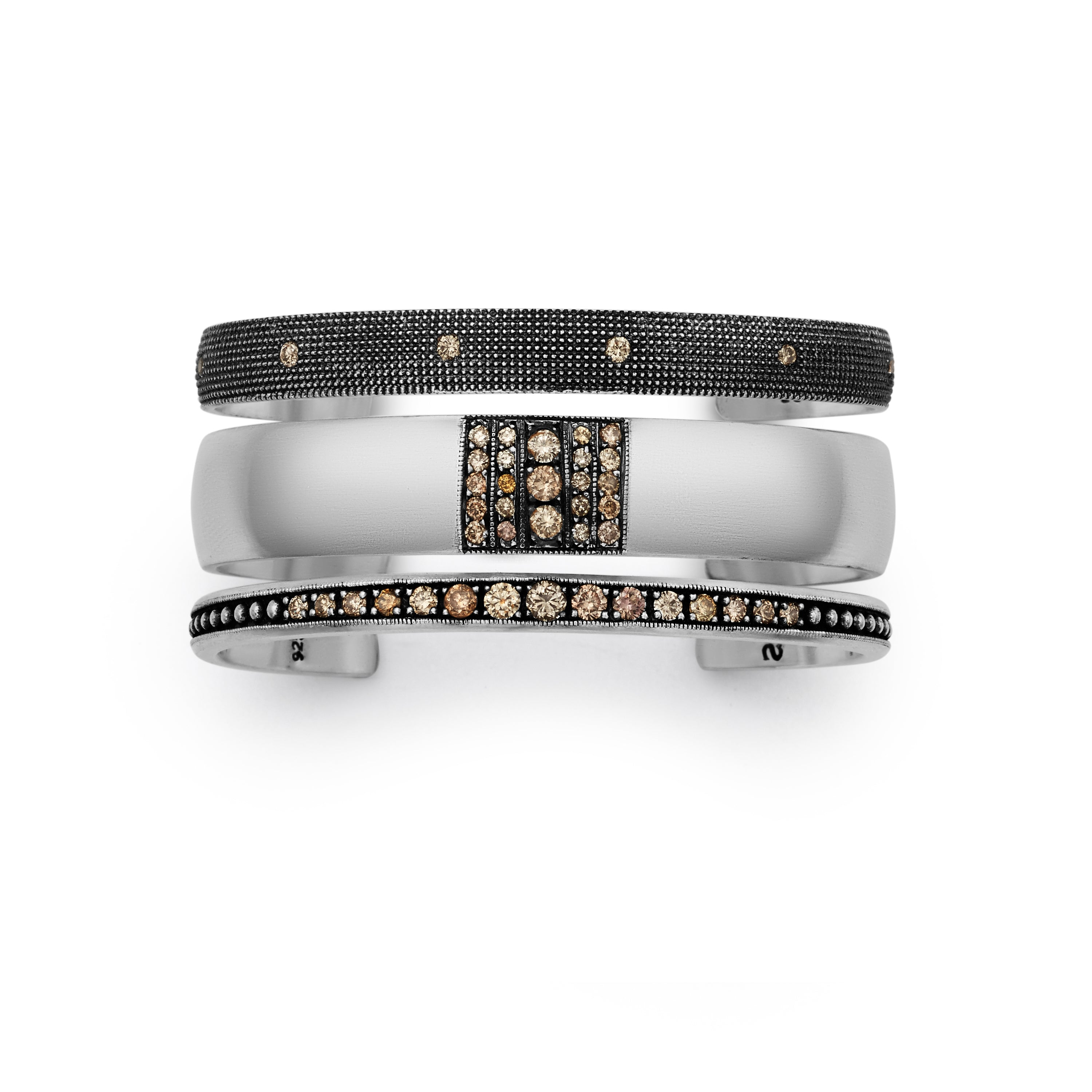 Vintage finish bright silver cuff stack with three cuffs featuring champagne diamonds