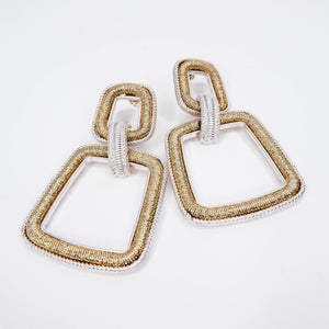 gold and silver interlock earrings