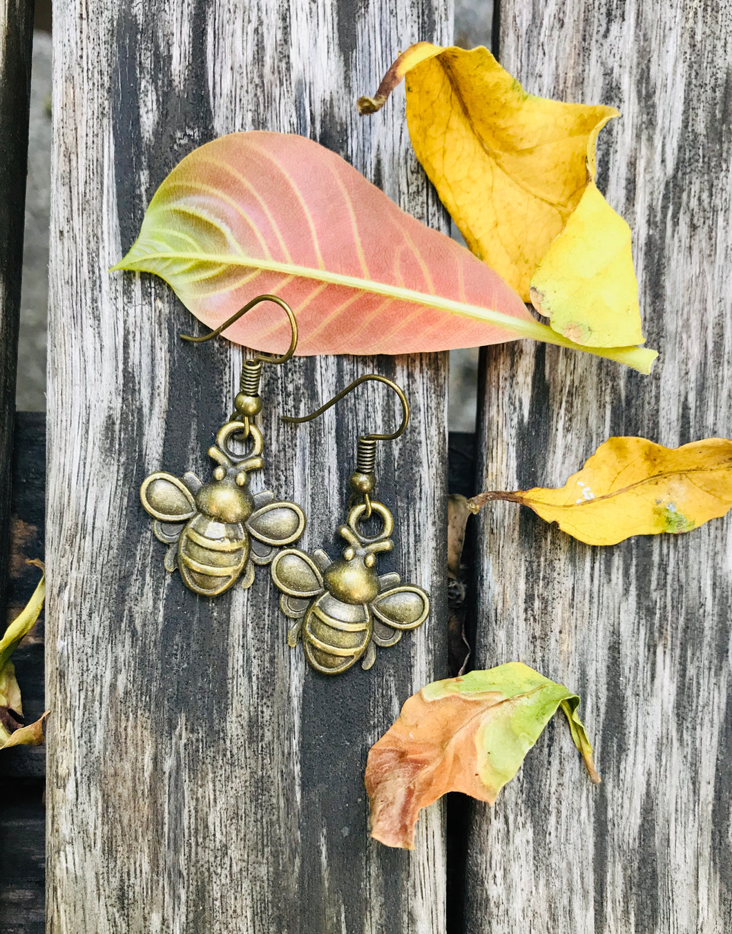Tarnished gold tone bee earrings