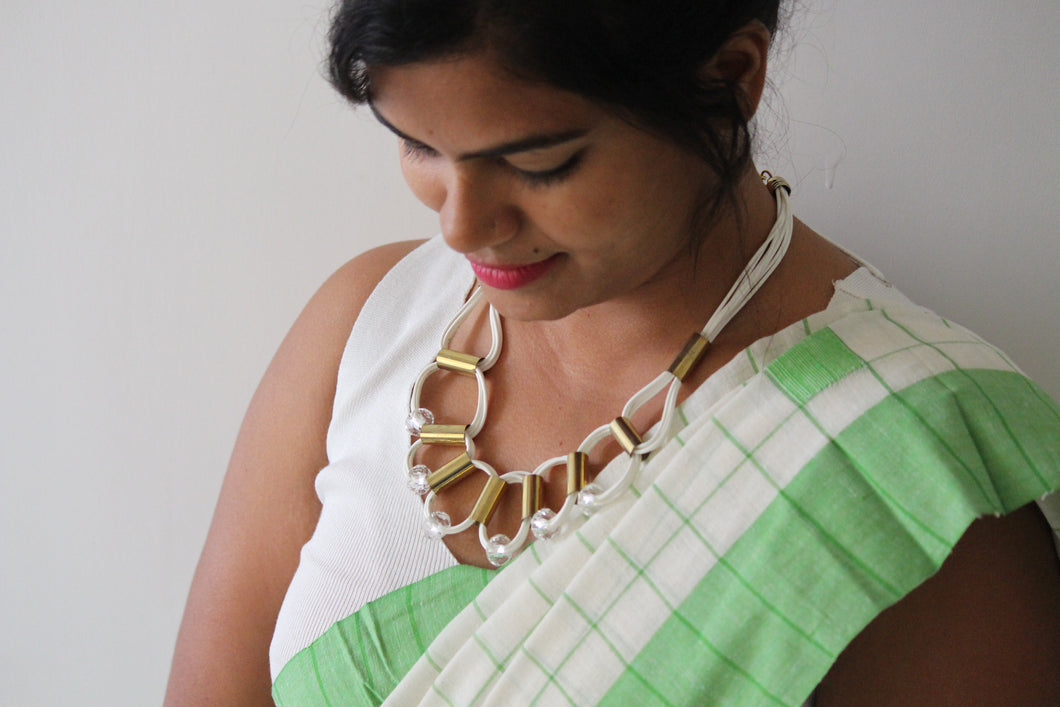 Cord with gold tone necklace
