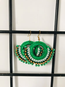 Green beaded earrings with thread work hook style