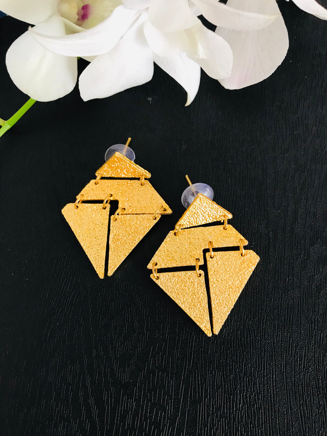 Kite shaped textured light gold tone abstract earrings
