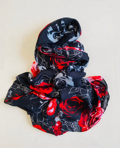 Red roses on navy blue scarf