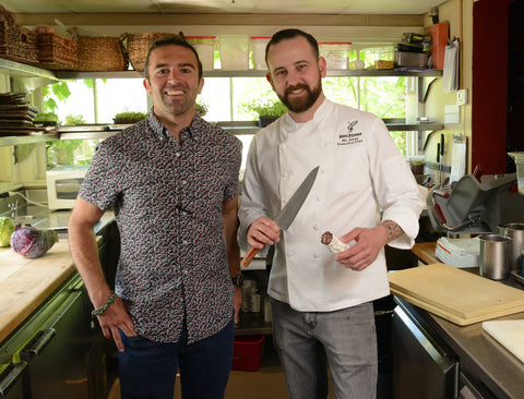 Executive Chef Nic Jones of Napa Valley's Goose & Gander poses with New West KnifeWorks COO Anthony Campolattaro