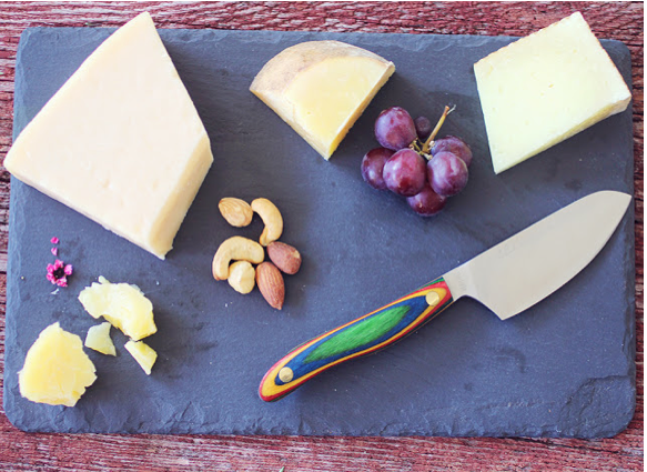 Gorgeous plate of Cheese with Cheese Knife