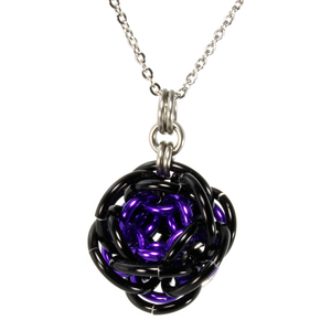 A purple and black aluminum rhosyn chainmaille pendant.