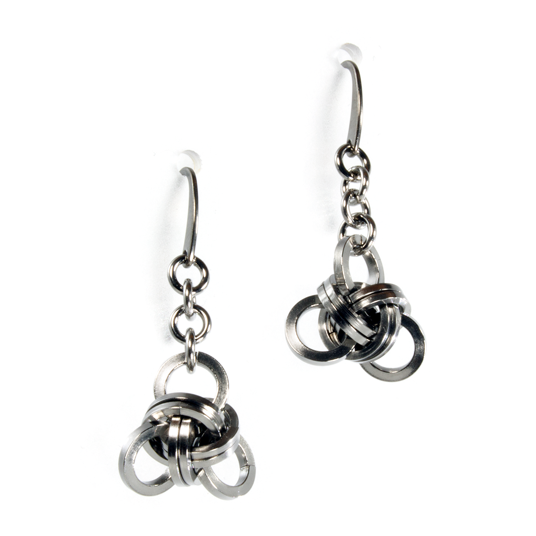 A pair of steel knotwork drop chainmaille earrings.
