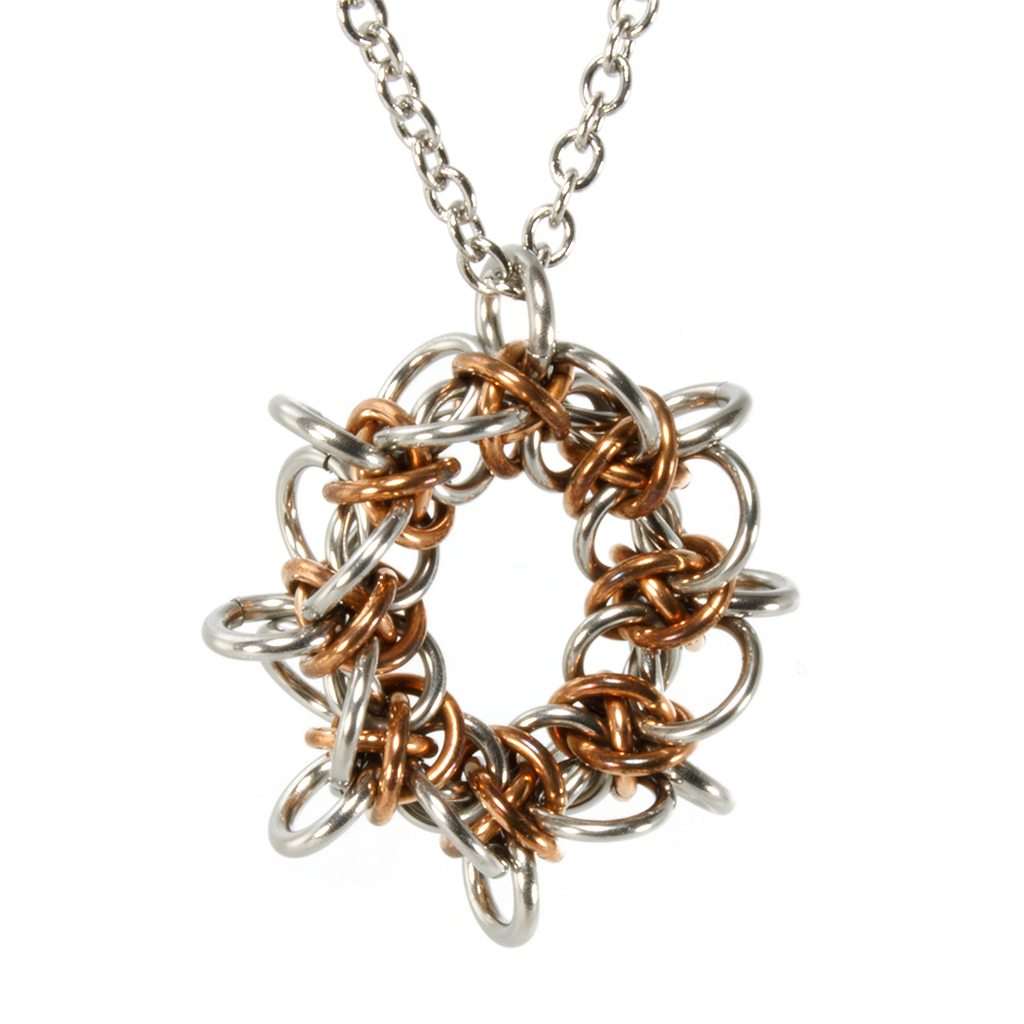 A bronze and steel triffids chainmaille pendant.