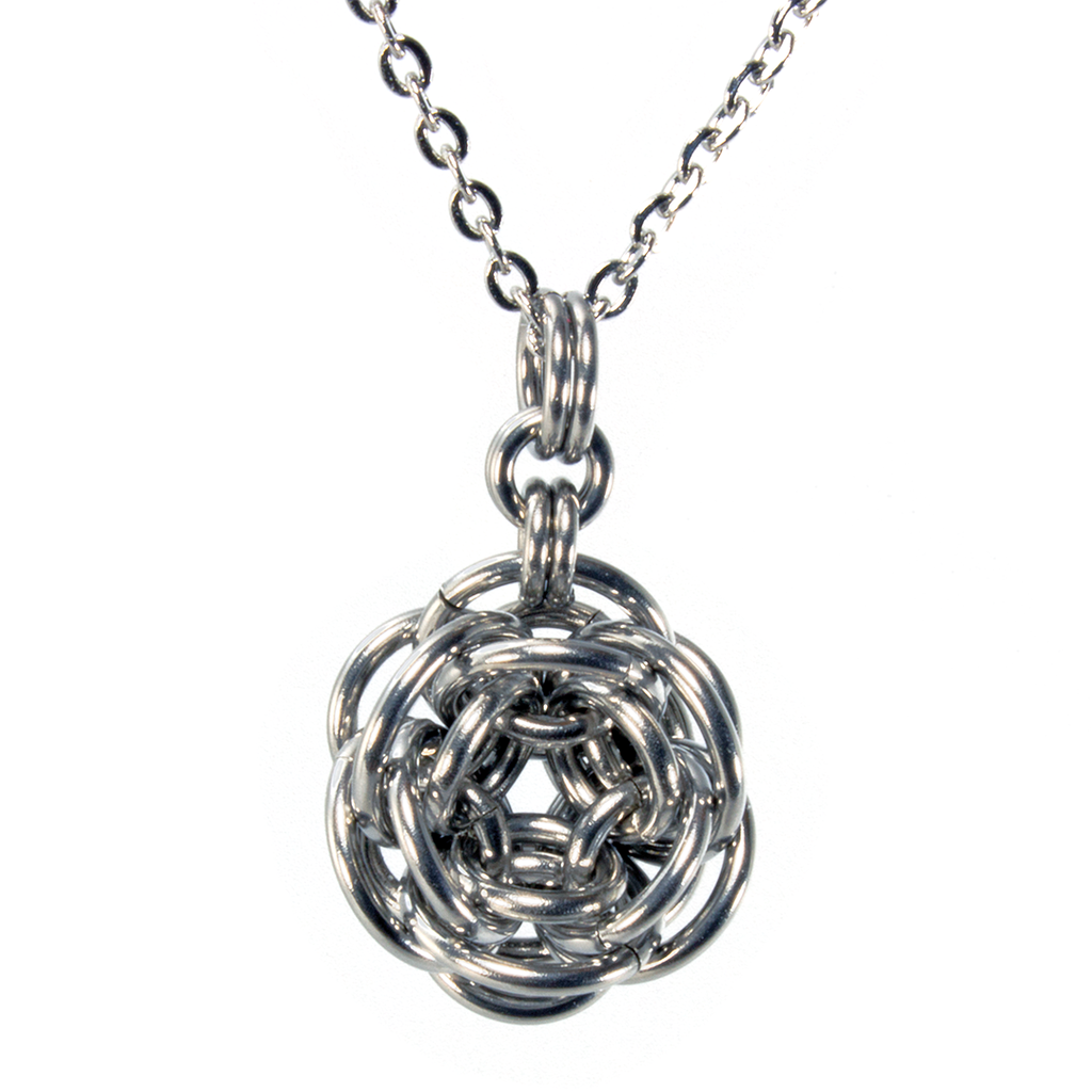 A steel rhosyn chainmaille pendant.