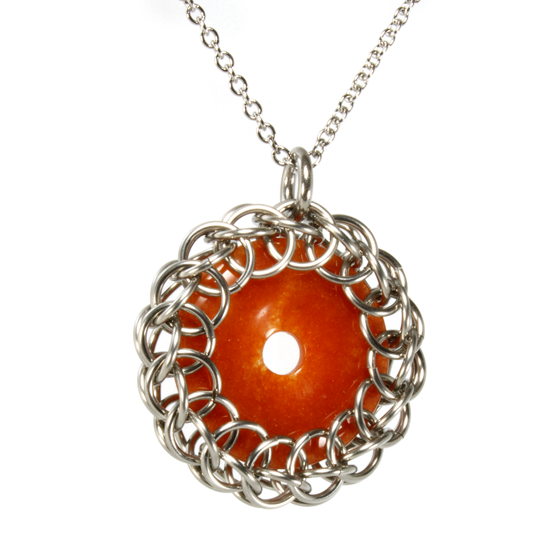 A steel and semi-precious stone persian chainmaille pendant.