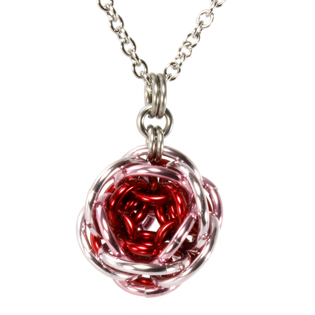 A red and pink aluminum rhosyn chainmaille pendant.