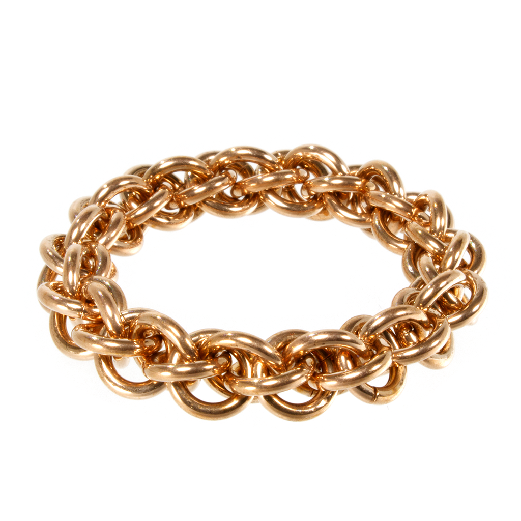 A bronze jens pind linkage chainmaille ring.