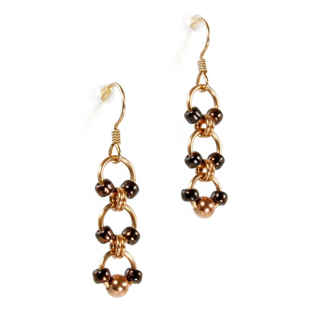 A pair of bronze japanese drop chainmaille earrings.