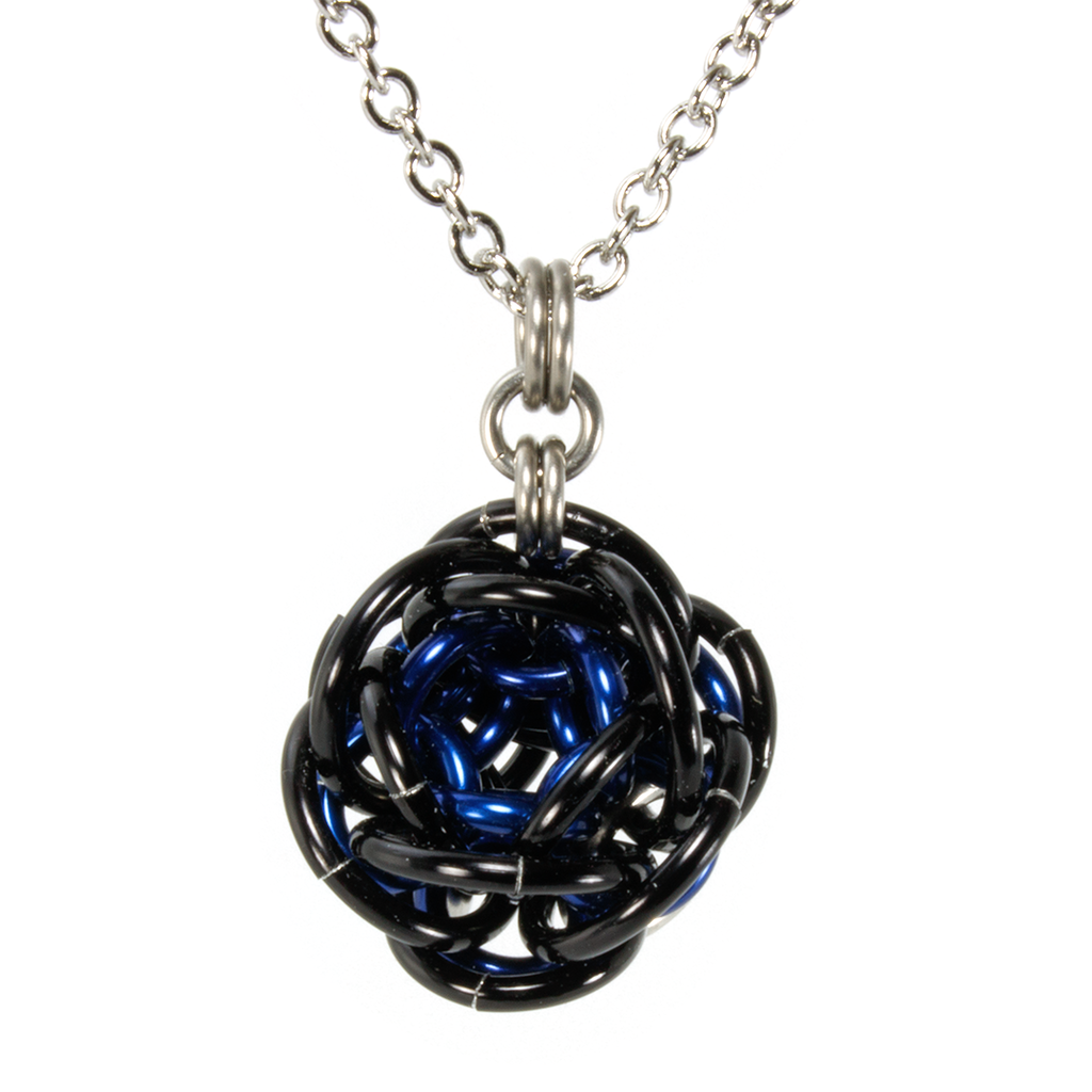 A blue and black aluminum rhosyn chainmaille pendant.
