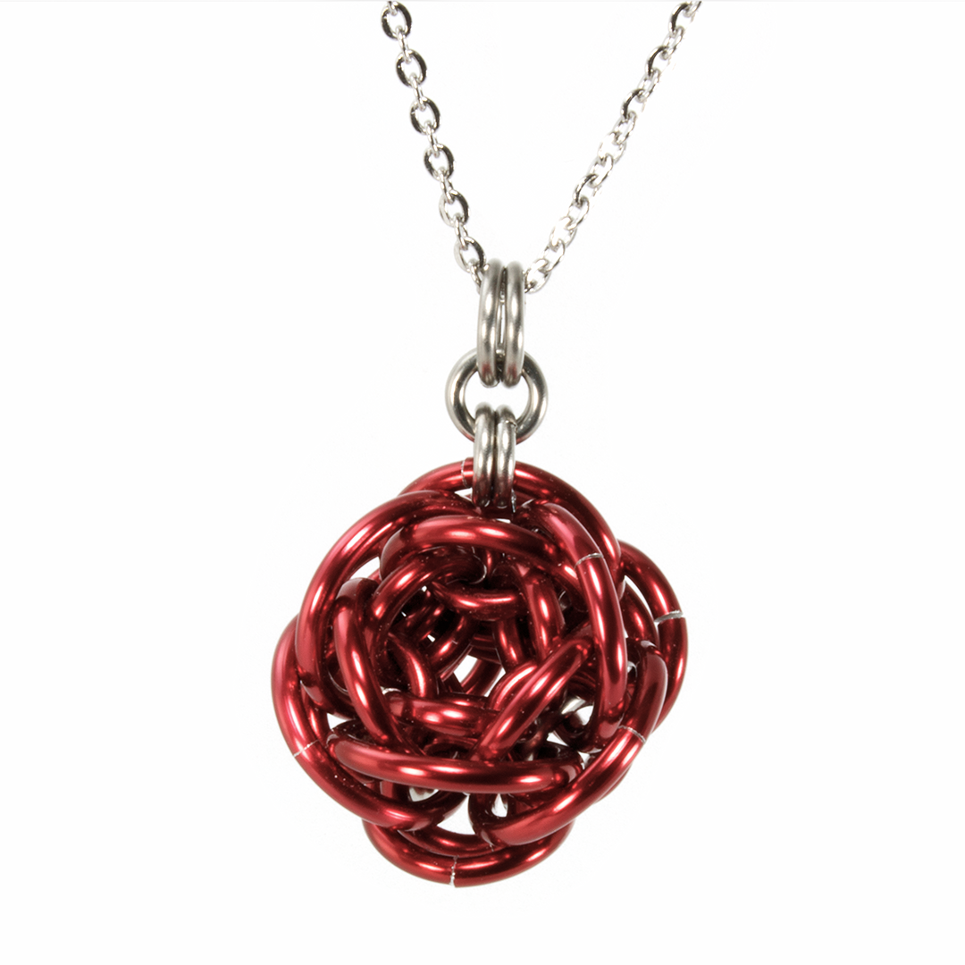 A red aluminum rhosyn chainmaille pendant.