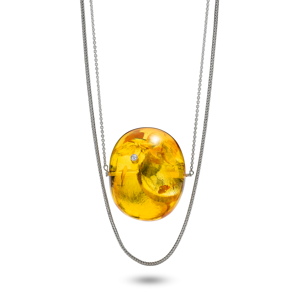 An Outstanding Necklace with Big and Unique Amber Bead in Light Cognac, Double Silver Chain and 0.05ct Diamond