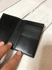 Gucci Embossed GG Folding Card Holder