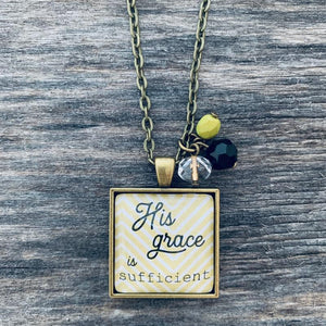 His grace is sufficient: bronze square